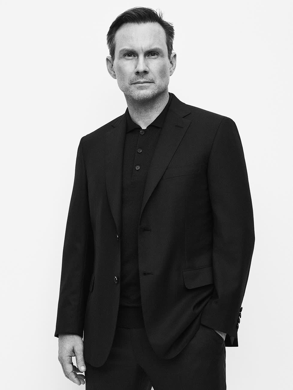 Christian Slater wearing a blazer, polo knit and trousers from the Brioni Essential collection