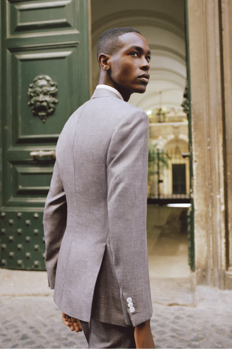 Male model wearing a Brioni purple suit in cashmere, silk and linen
