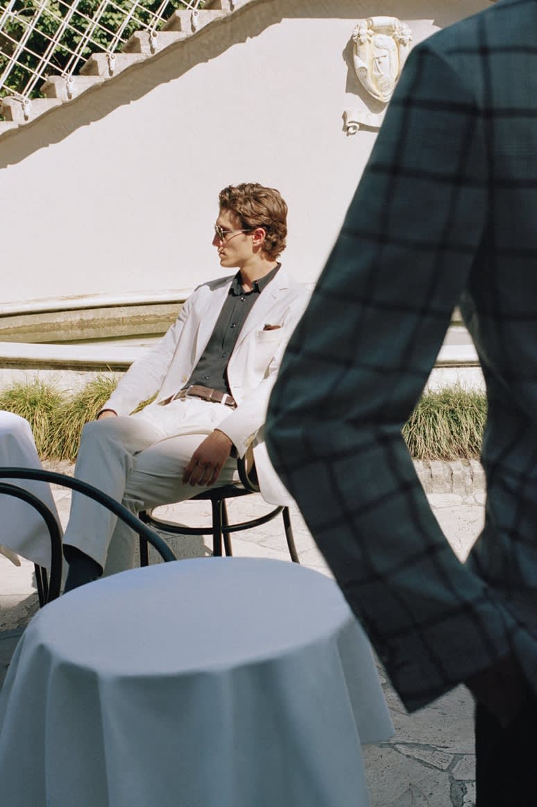 Male model wearing a Brioni beige suit in Sea Island cotton