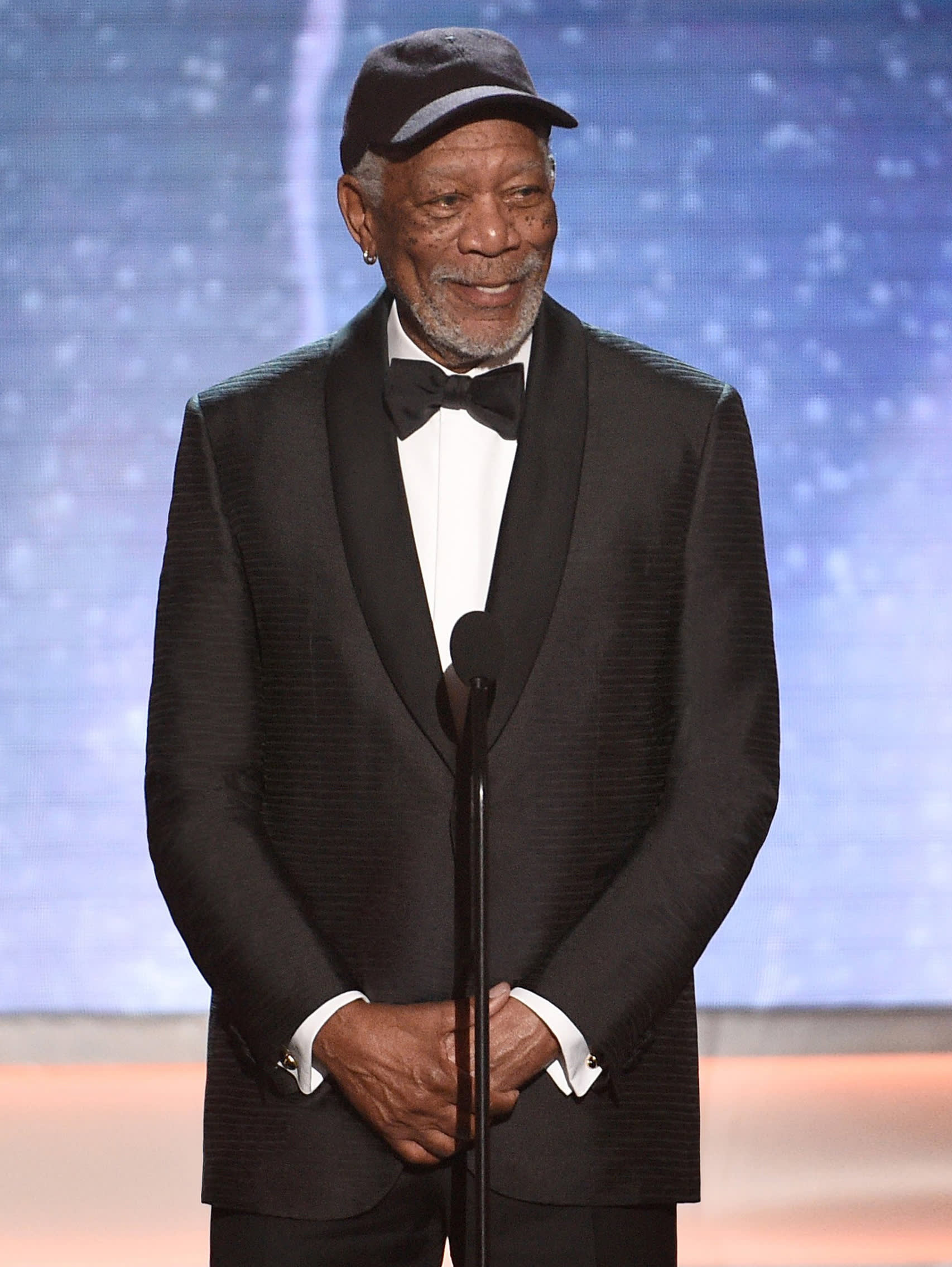 Morgan Freeman wearing a Brioni bespoke black tuxedo
