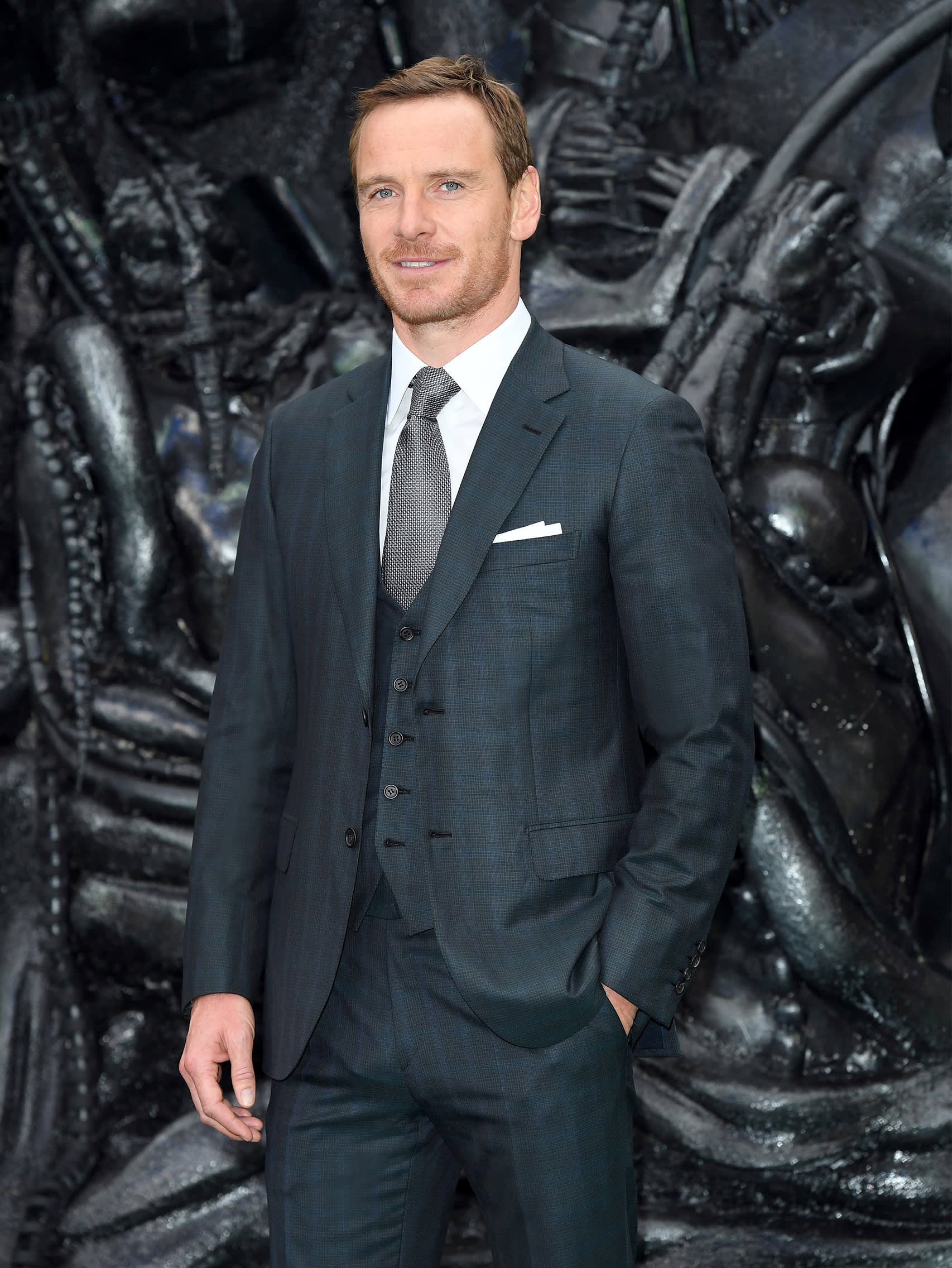 Michael Fassbender wearing a Brioni bespoke dark green three-piece suit