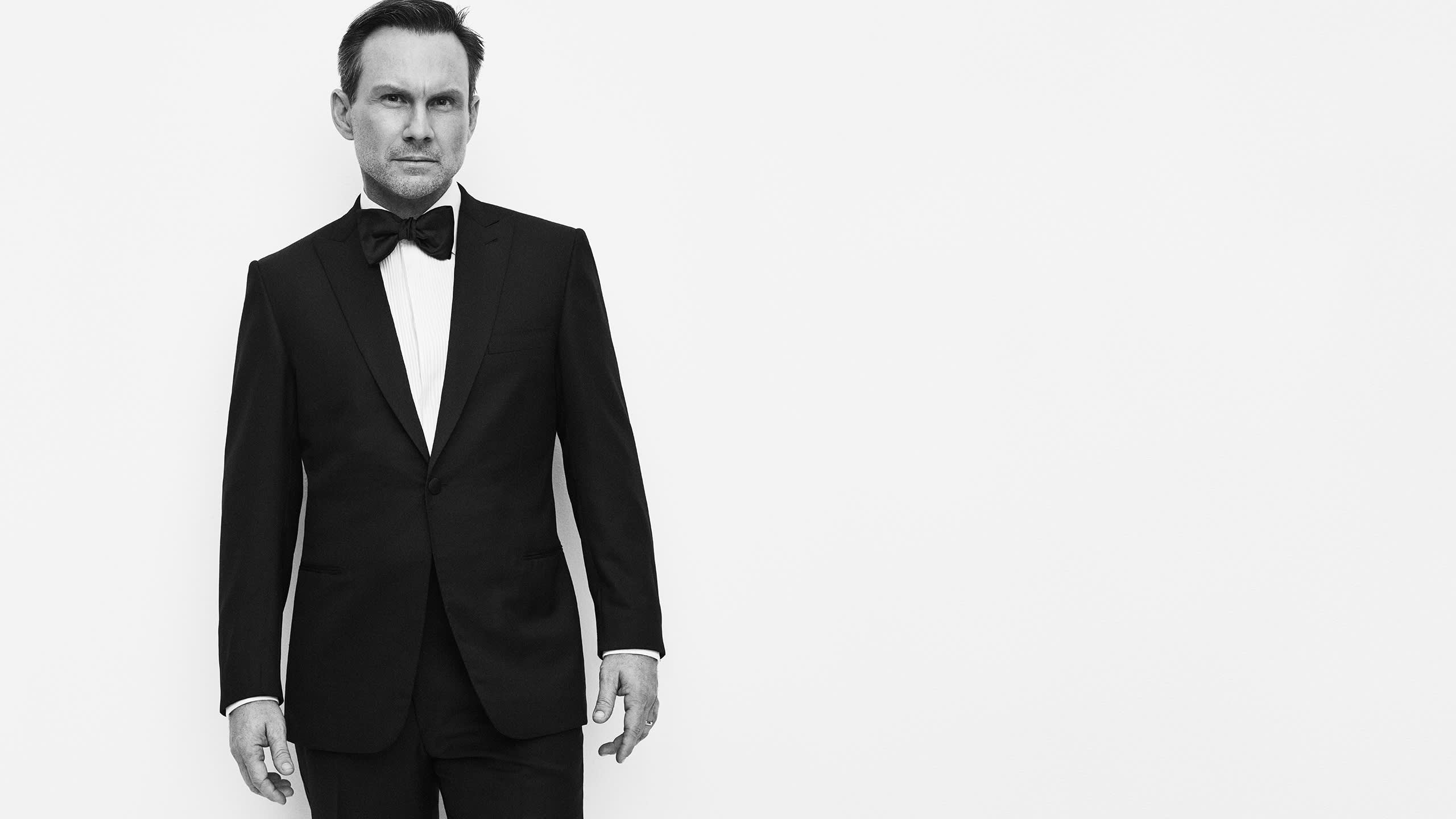 Christian Slater wearing a tuxedo, evening shirt and bow tie from the Brioni Essential collection