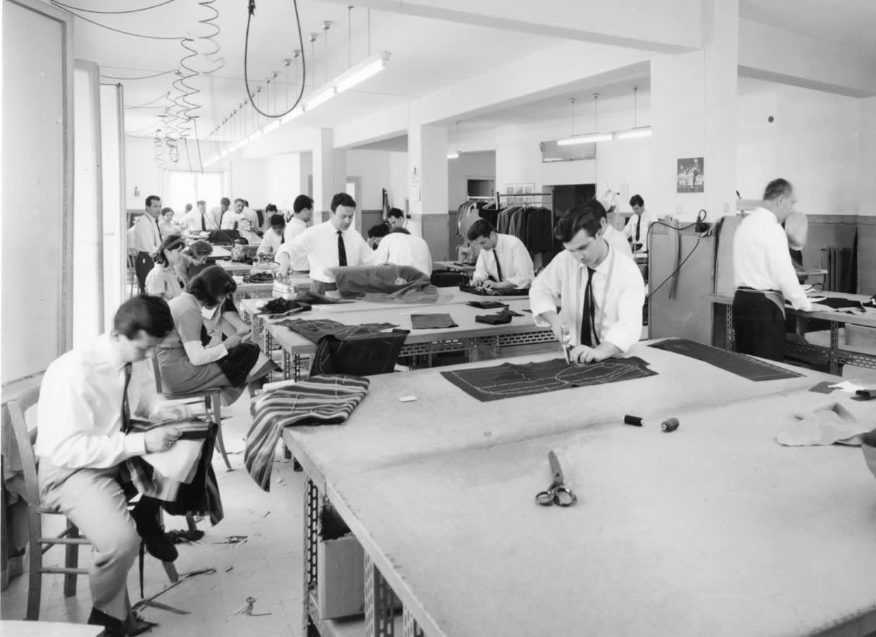 Tailors and seamstresses at work in the Brioni atelier in Rome, 1960s