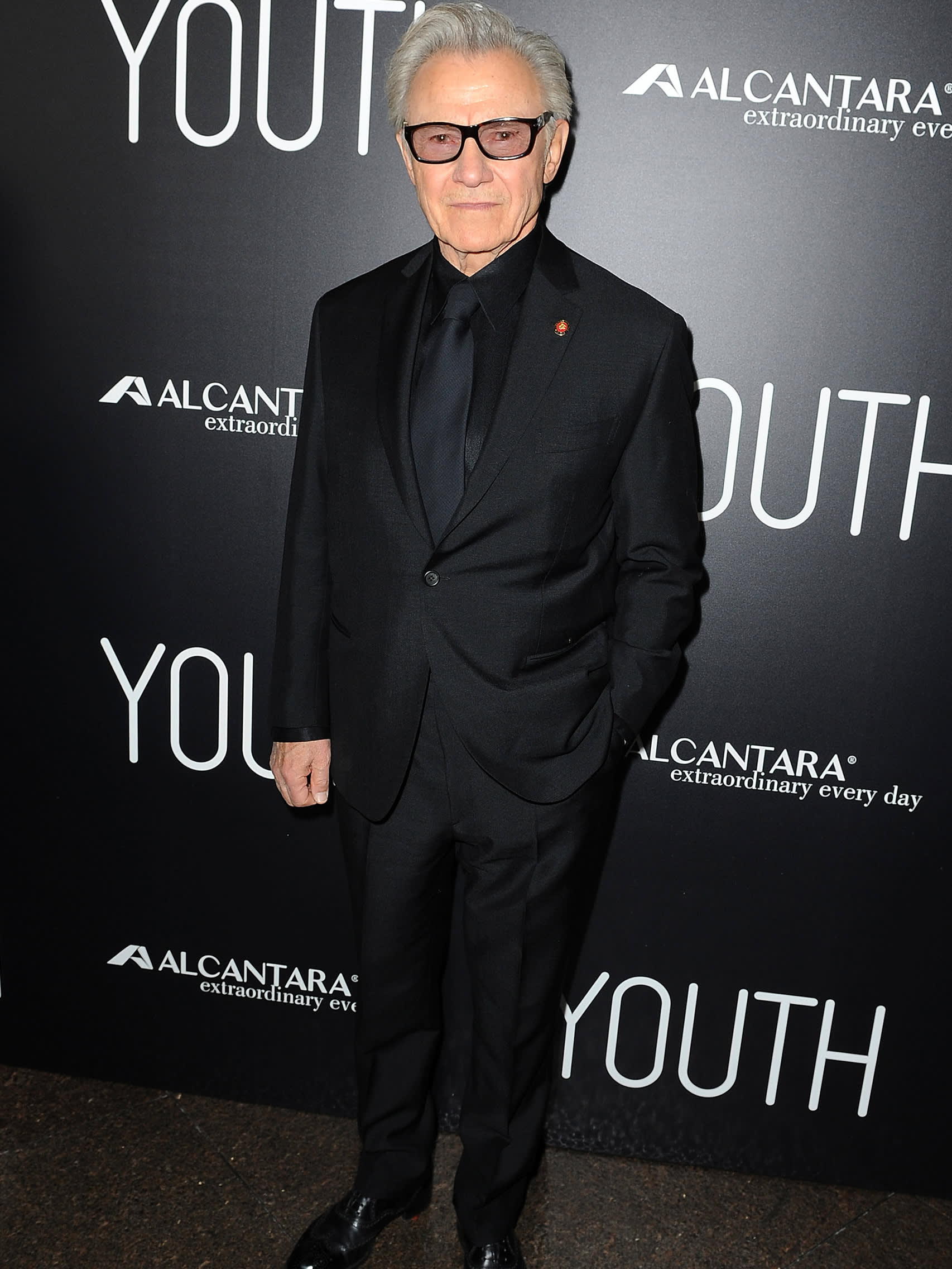 Harvey Keitel wearing a Brioni bespoke black suit