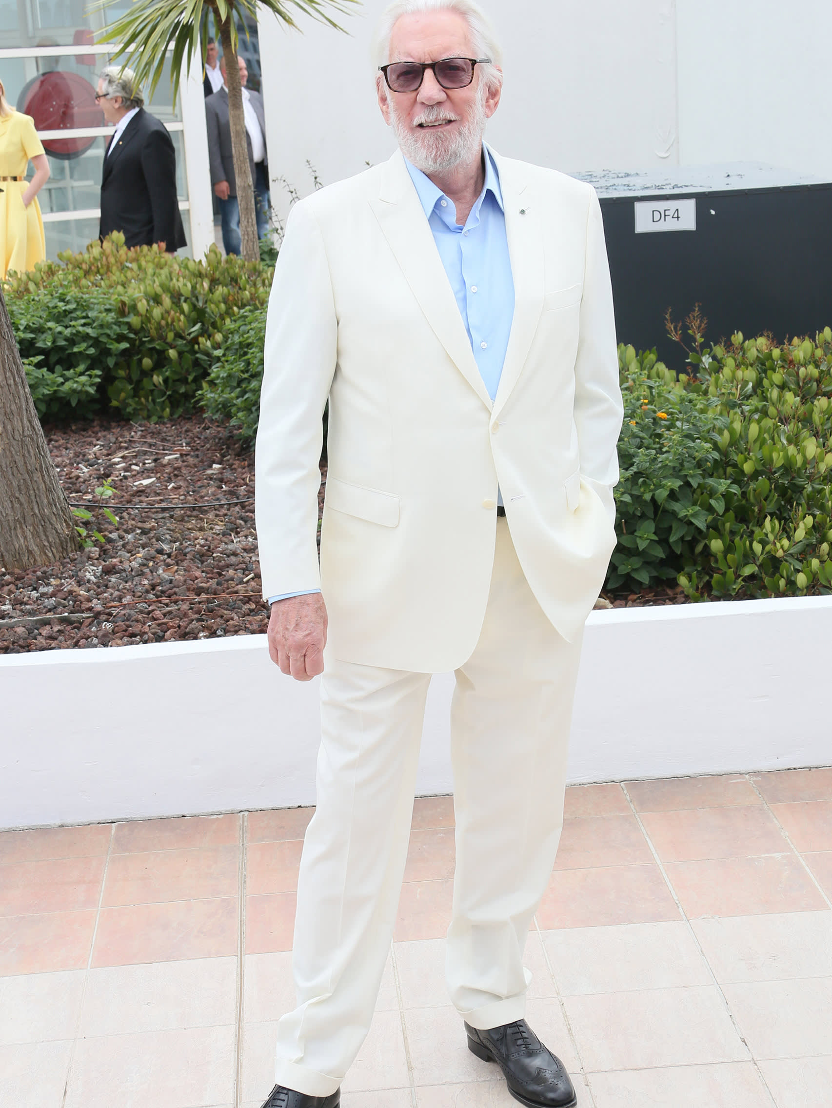Donald Sutherland wearing a Brioni bespoke white suit