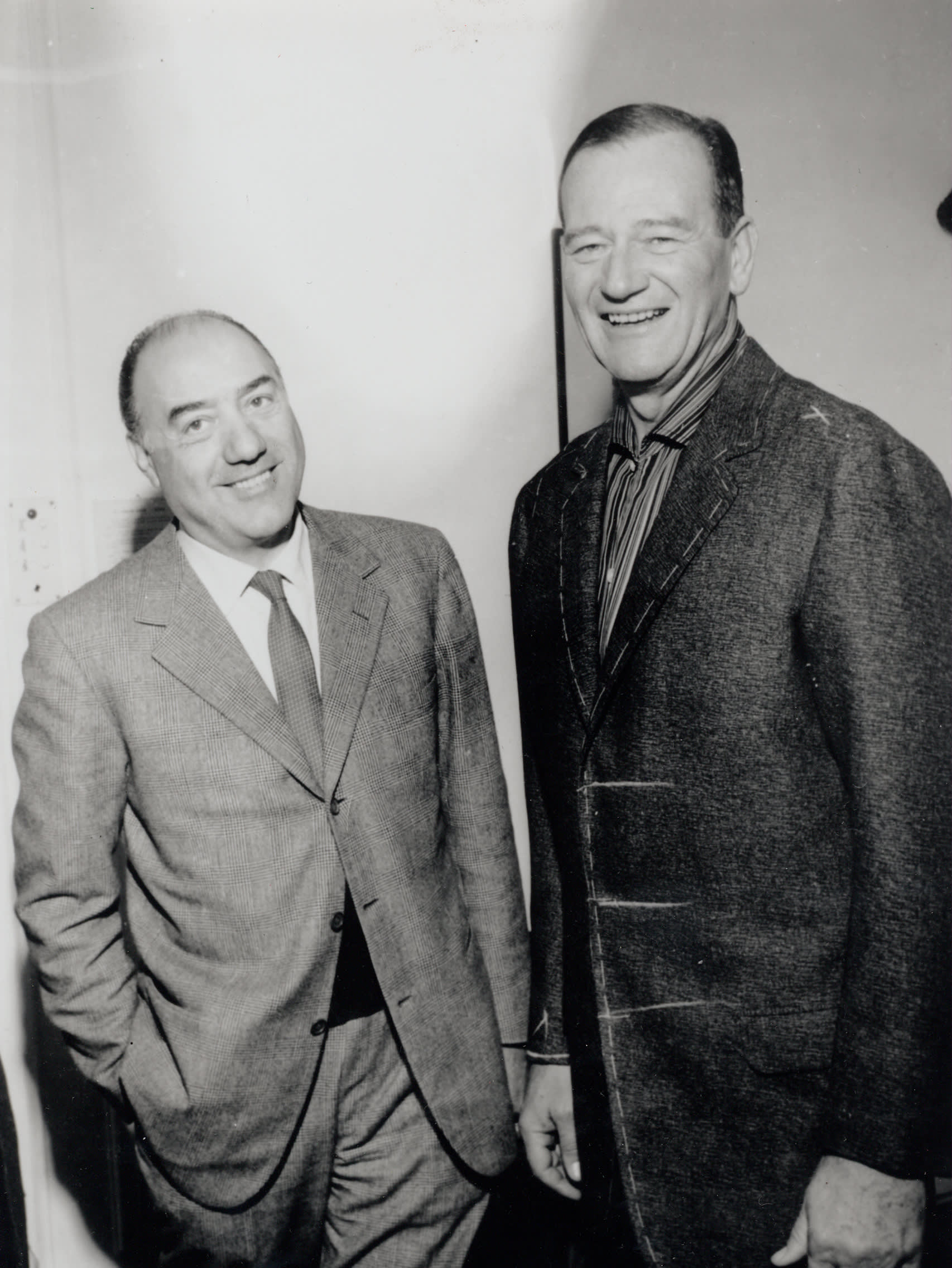 Brioni founder Gaetano Savini with American actor John Wayne