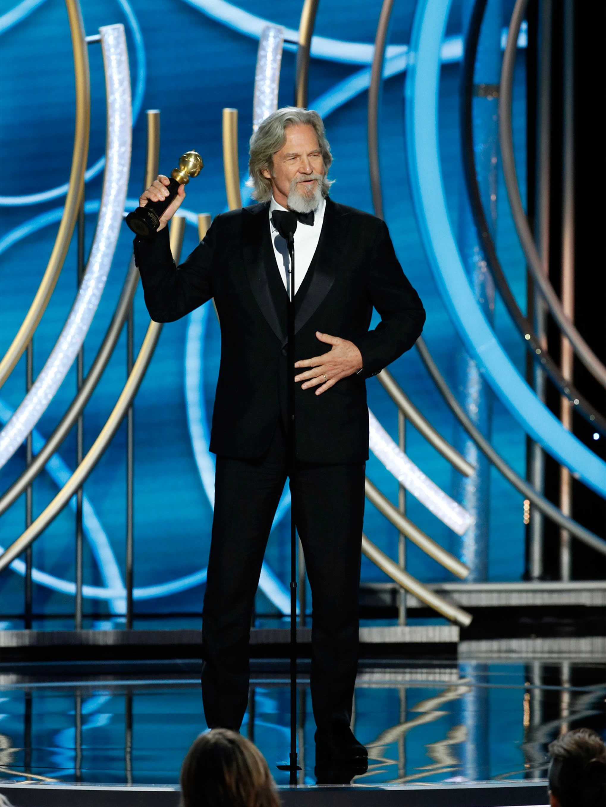 Jeff Bridges wearing a Brioni bespoke black three-piece tuxedo