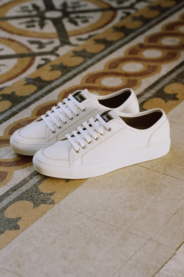A pair of white Brioni sneakers in deerskin