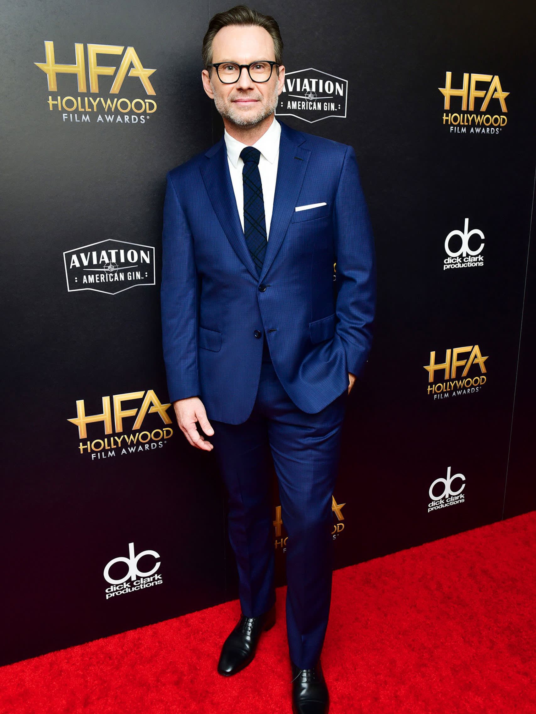 Christian Slater wearing a Brioni bespoke blue suit