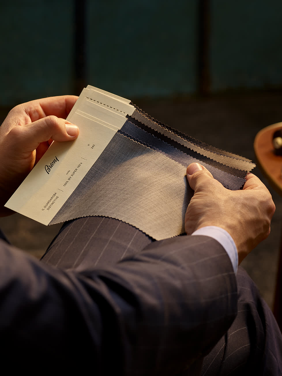 A Brioni master tailor shows a selection of Bespoke fabrics