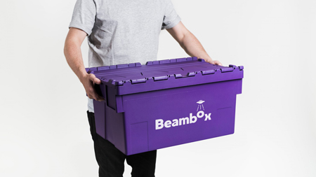 Man carrying a purple Beambox container.