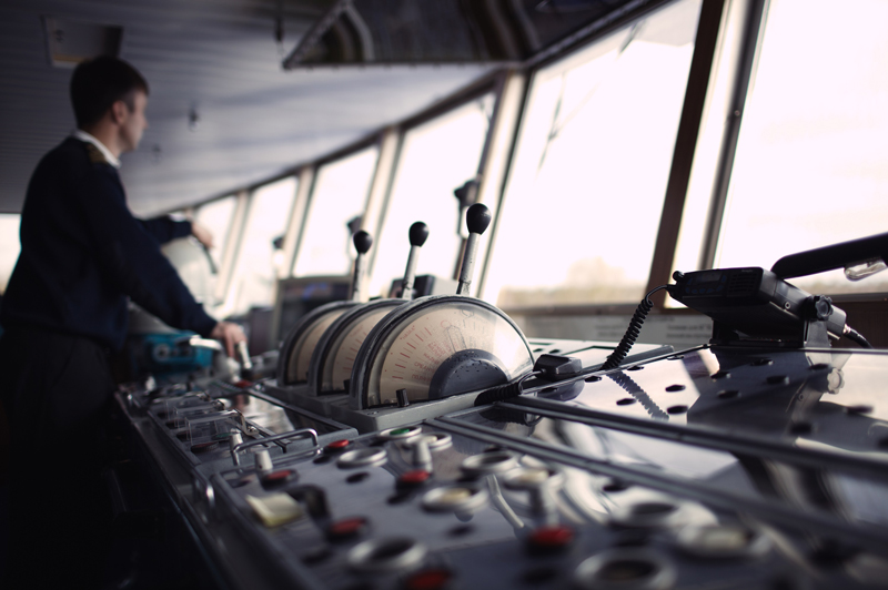 Photo from the bridge of a Wilhelmsen ship, showing various controllers.