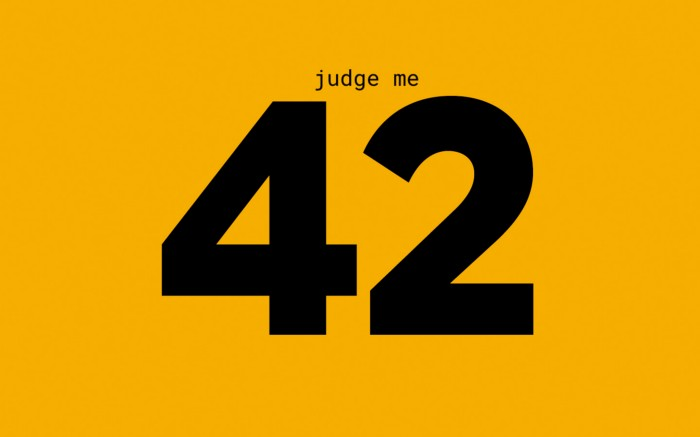 "The number 42 on orange background with the words ""judge me"" above"