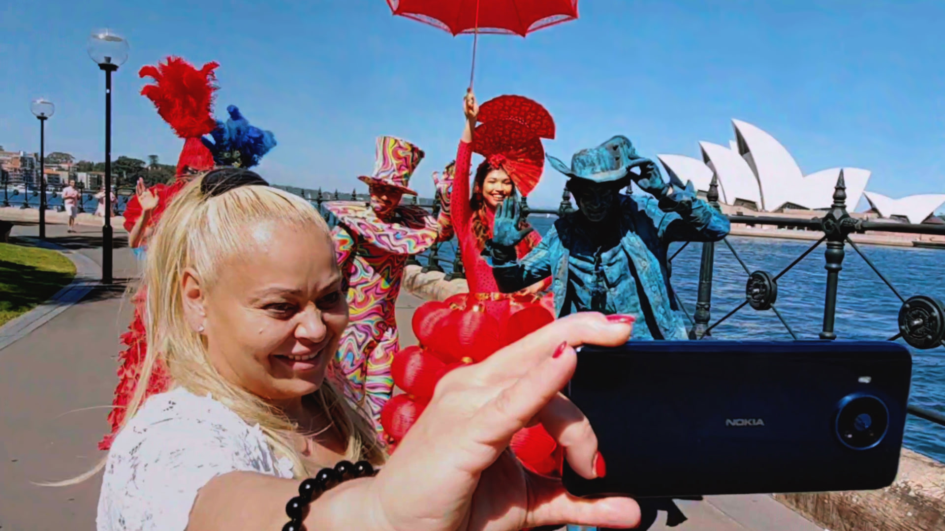 A woman taking a selfie with a Nokia device at a festival in Syndey.