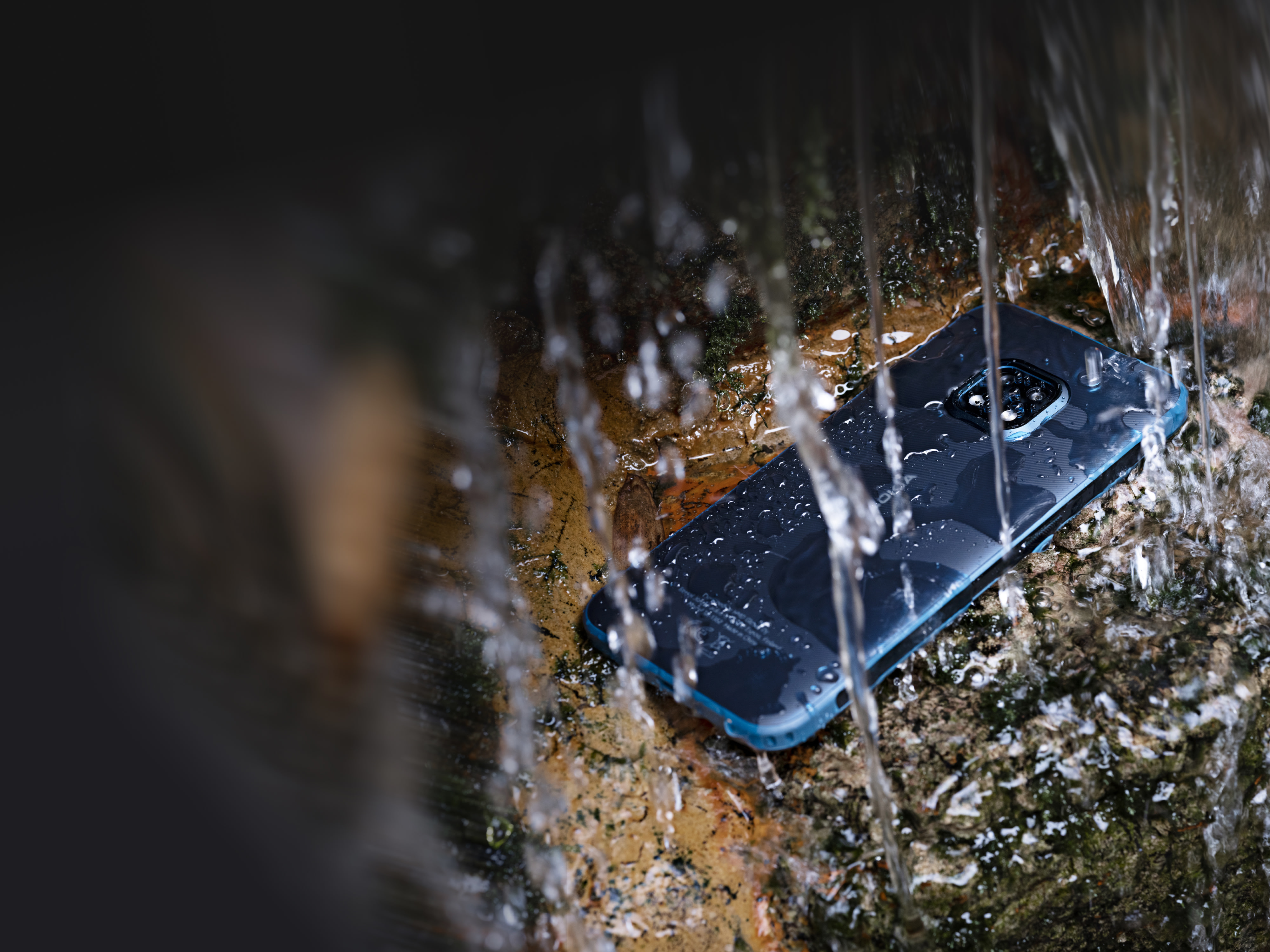 The robust Nokia XR20 phone enduring heavy water exposure.