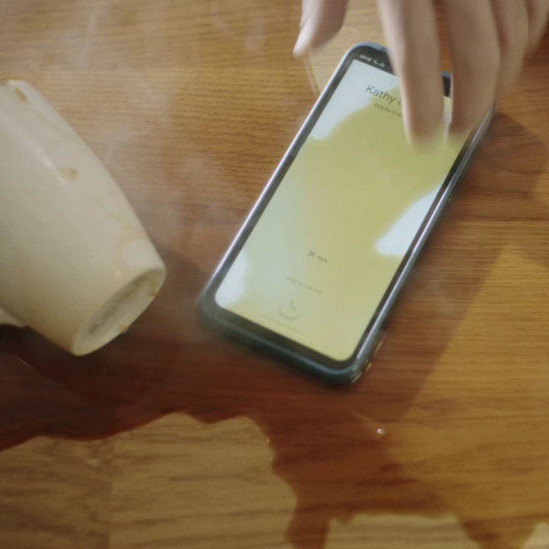 The durable Nokia XR20 smartphone enduring a coffee spill.
