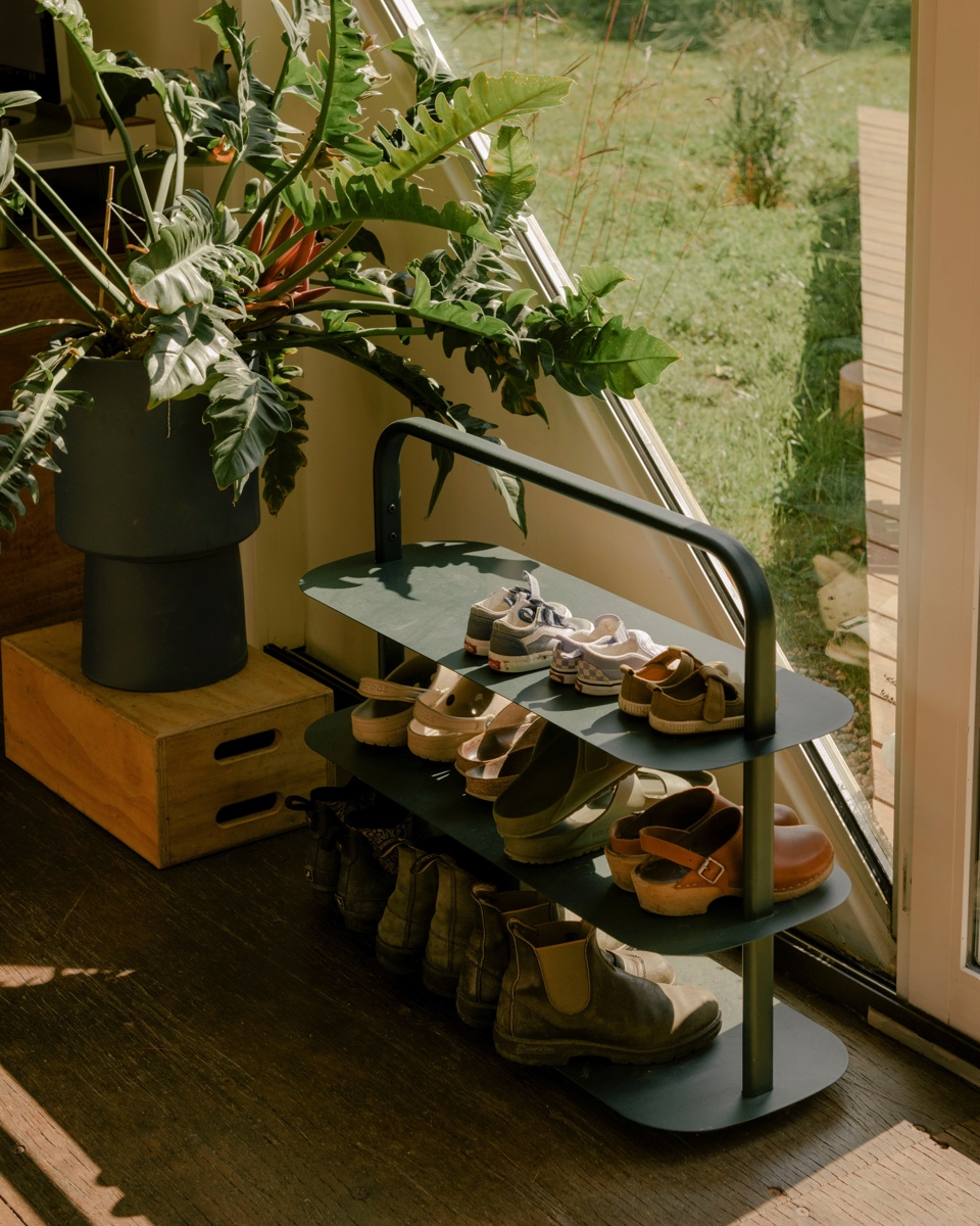 An open spaces shoe rack.