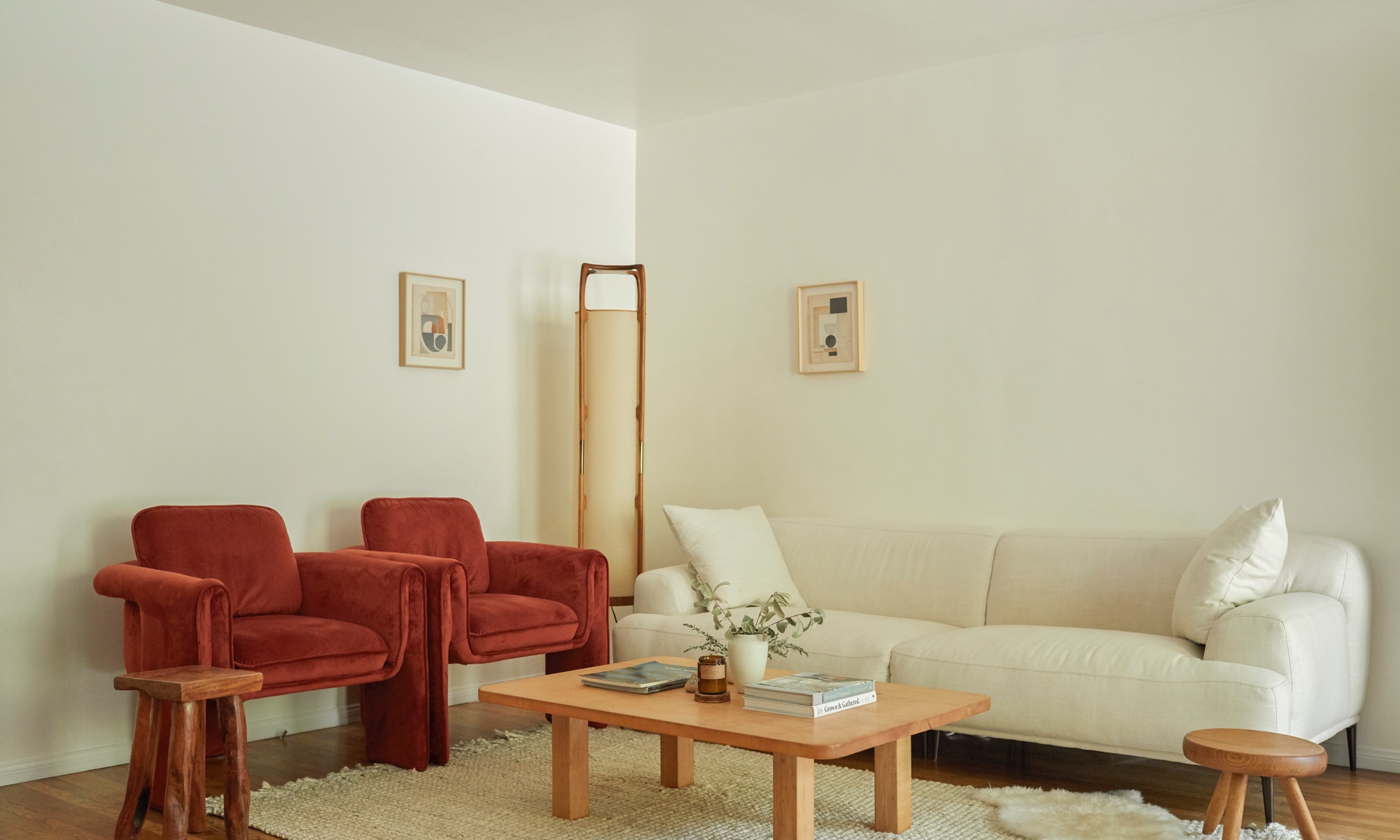 The orange-y red chairs are favorites of Jodi's. Her collection of wooden stools proves multifunctional in the space.