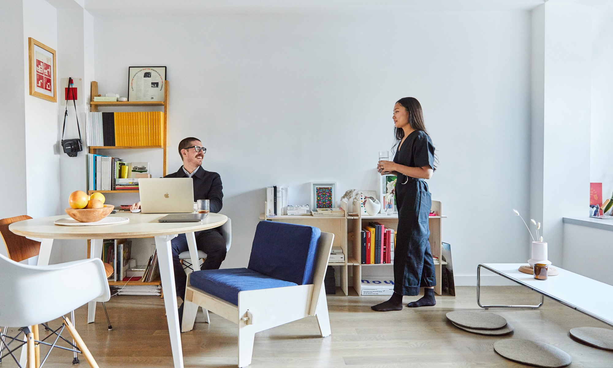 Jesse + Estee in their NYC apartment with a Floyd table.