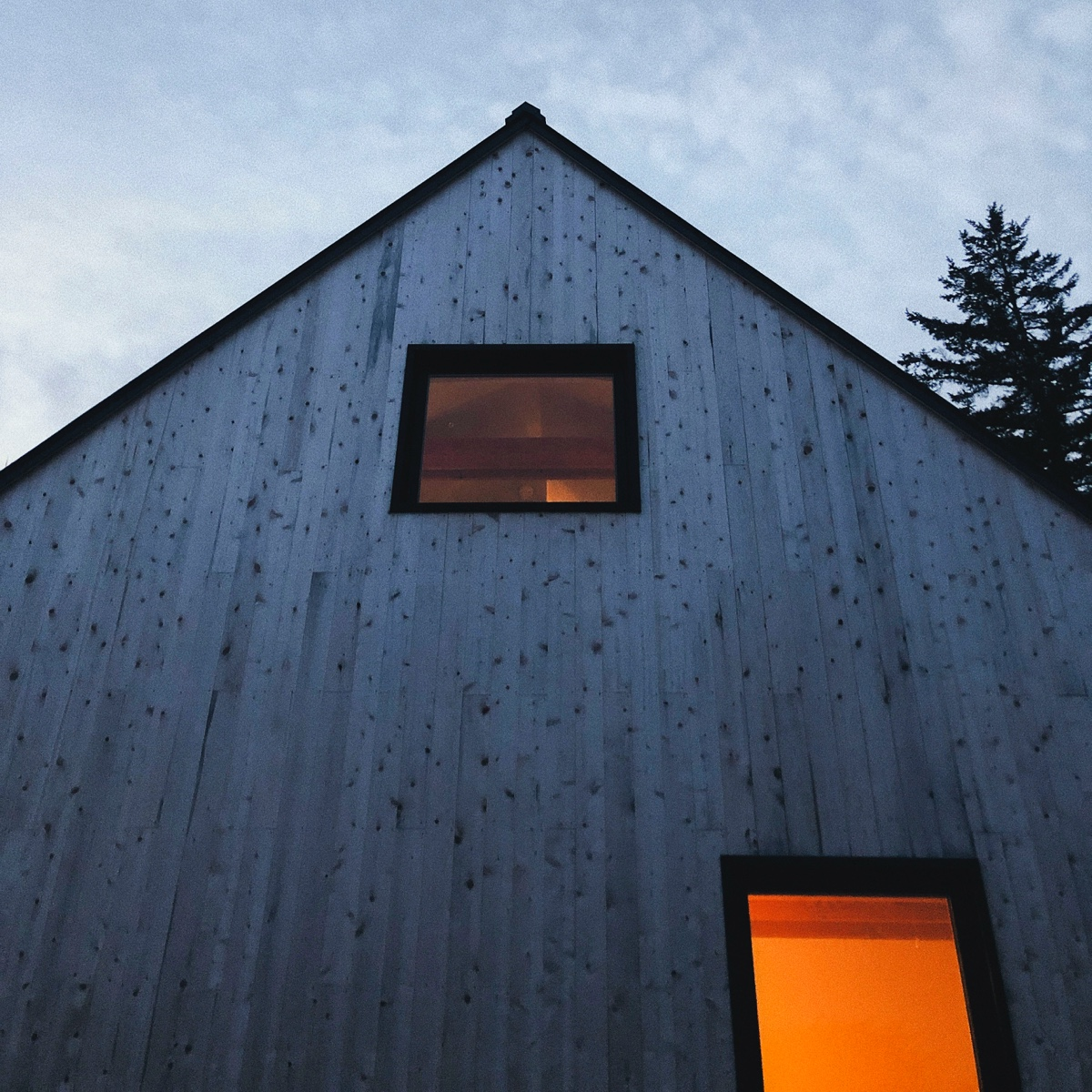 The simple facade fits beautifully into the wild Maine surroundings — and adds a beautiful cedar scent to the space year-round.