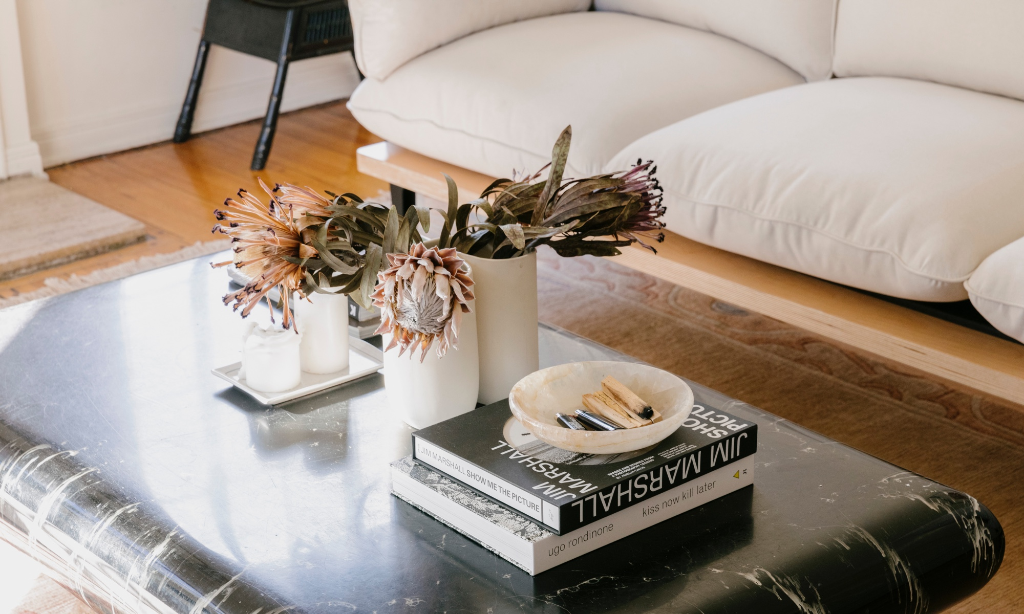 A showstopping marble slab coffee table next to the Floyd Sofa in Oat