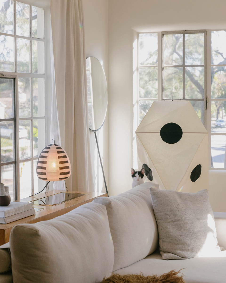 Noguchi lamps in a white living room.