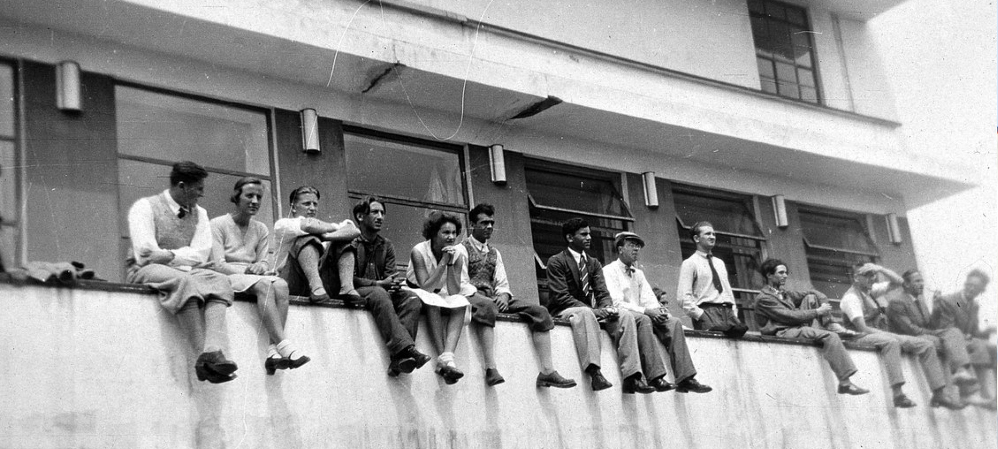 Bauhaus students on a balcony.