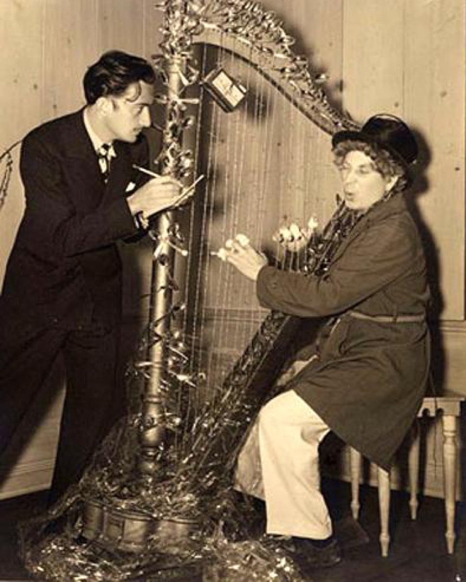 Dali once gifted Harpo Marx (of the Marx brothers) a harp with barbed wire for string. Apparently, Harpo staged this photo and sent it to Dali after receiving the gift.
