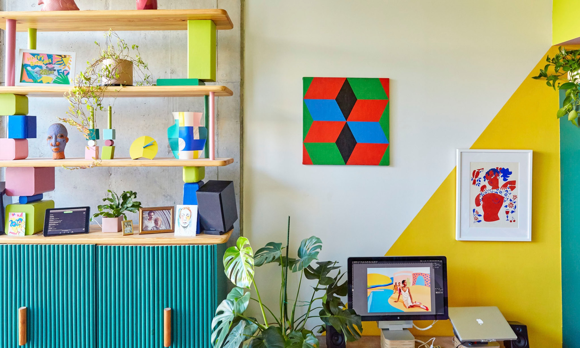 The home also serves as a workspace for the creative pair, and a cheerful yellow triangle defines the desk area.