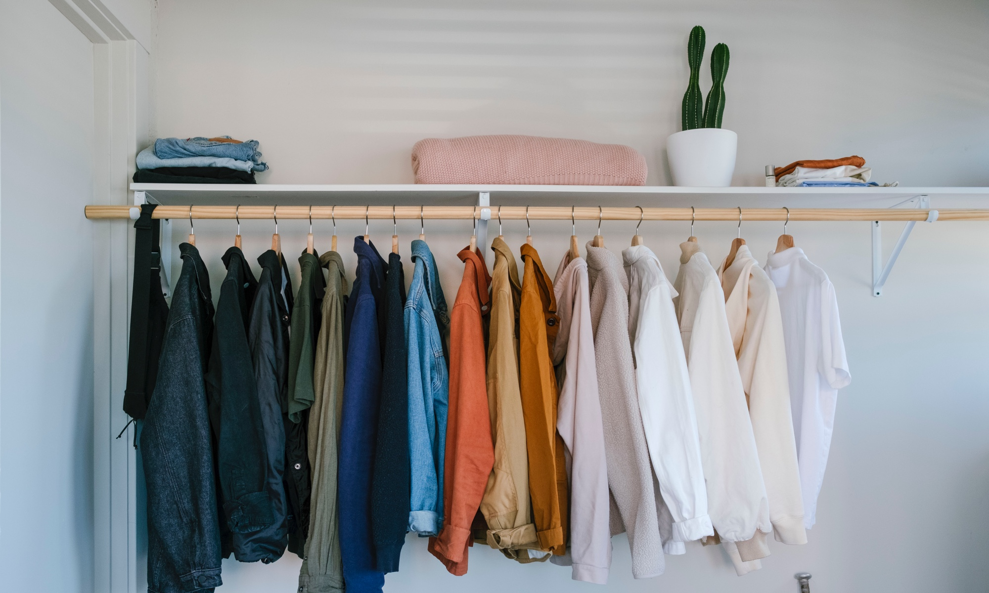 A curated wardrobe seems well-matched with the space.
