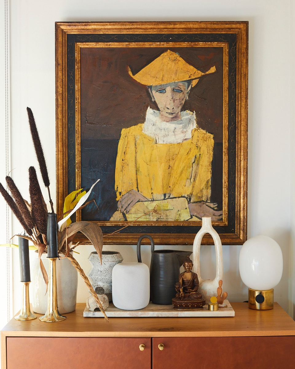 A family-heirloom painting watches over the dining area.