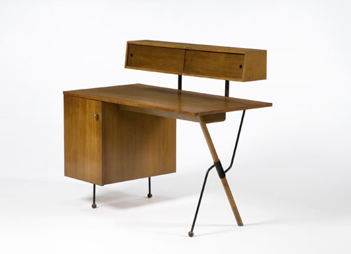 A desk designed by Grossman, with her signature slender legs & mixed materials.