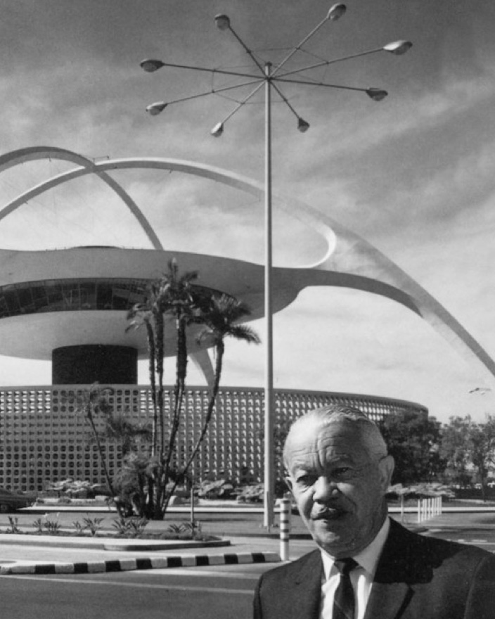 Williams in front of the Theme building at LAX. Image via the Paul Revere Williams Project.