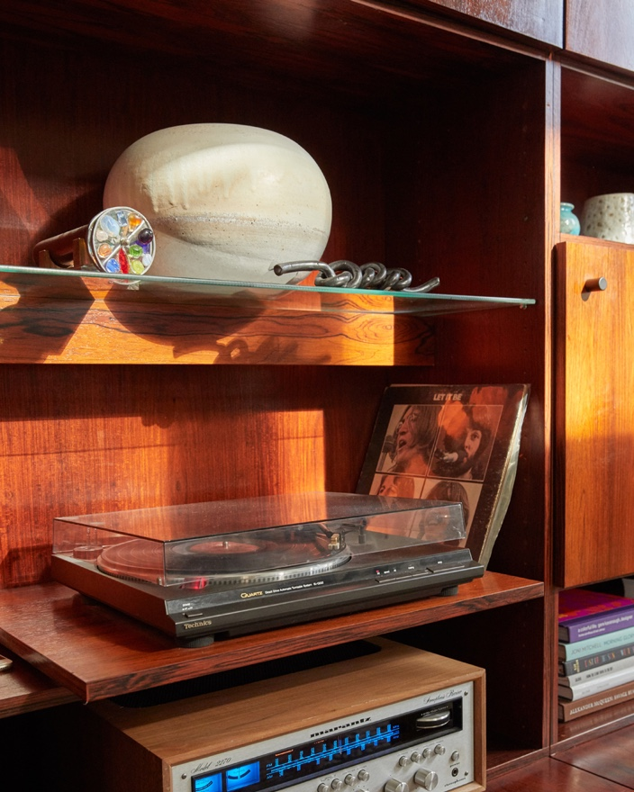 Rosewood cabinet with a record player.