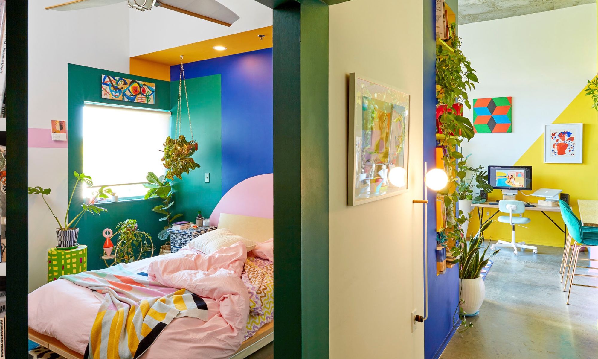 The green and blue from the living space flow into the bedroom.