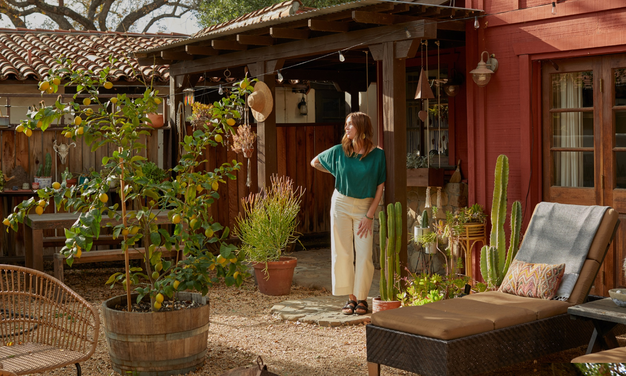 Sally England stands in the courtyard of her Ojai home.