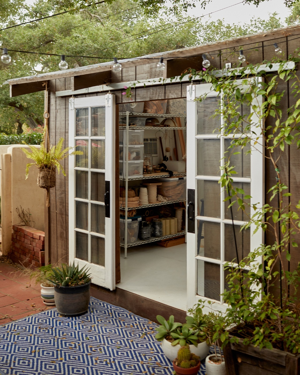Sliding doors allow the workshop to open onto the patio.