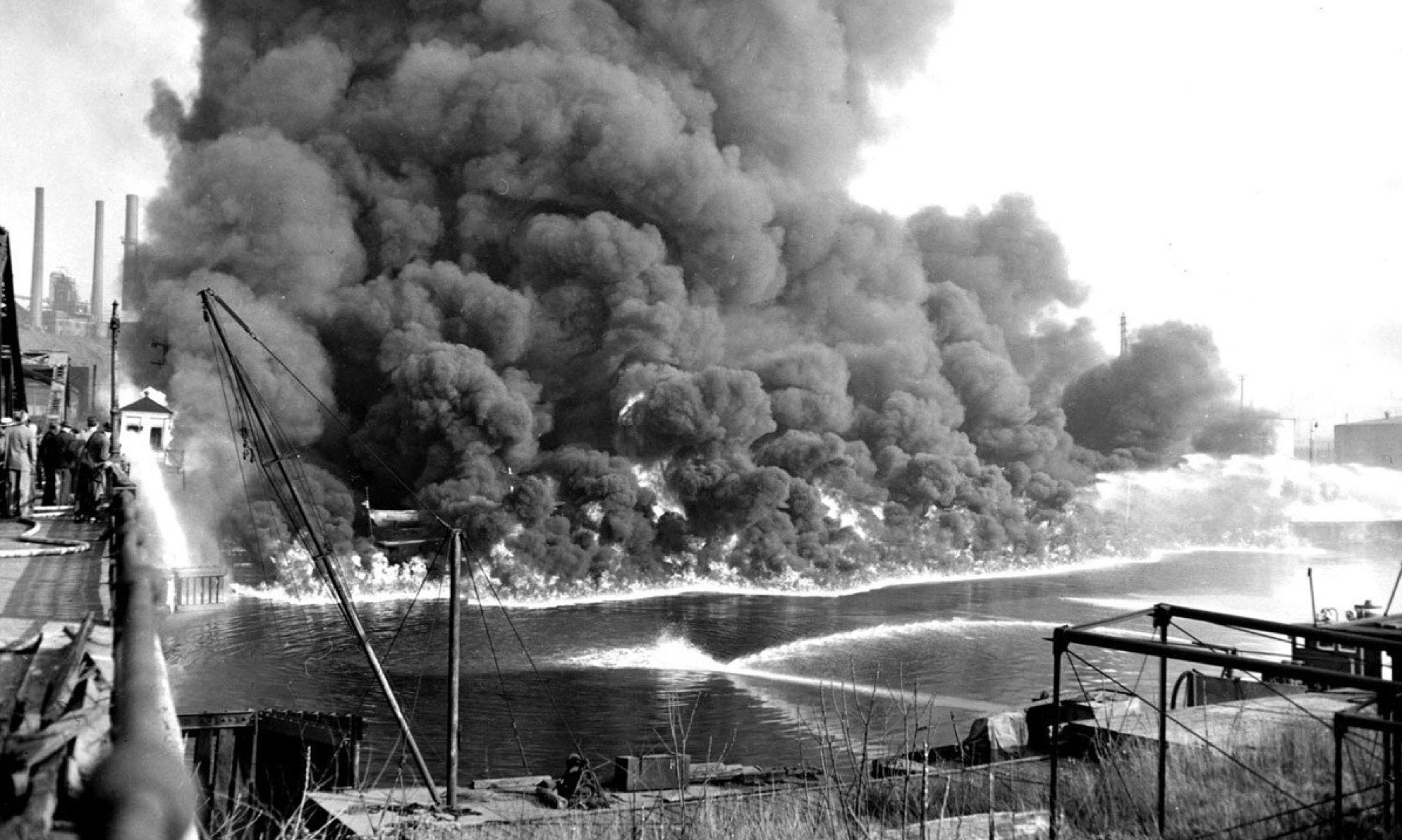 In 1969, the heavily polluted Cuyahoga River caught fire in Cleveland, Ohio. Image via the Cleveland State University Library.