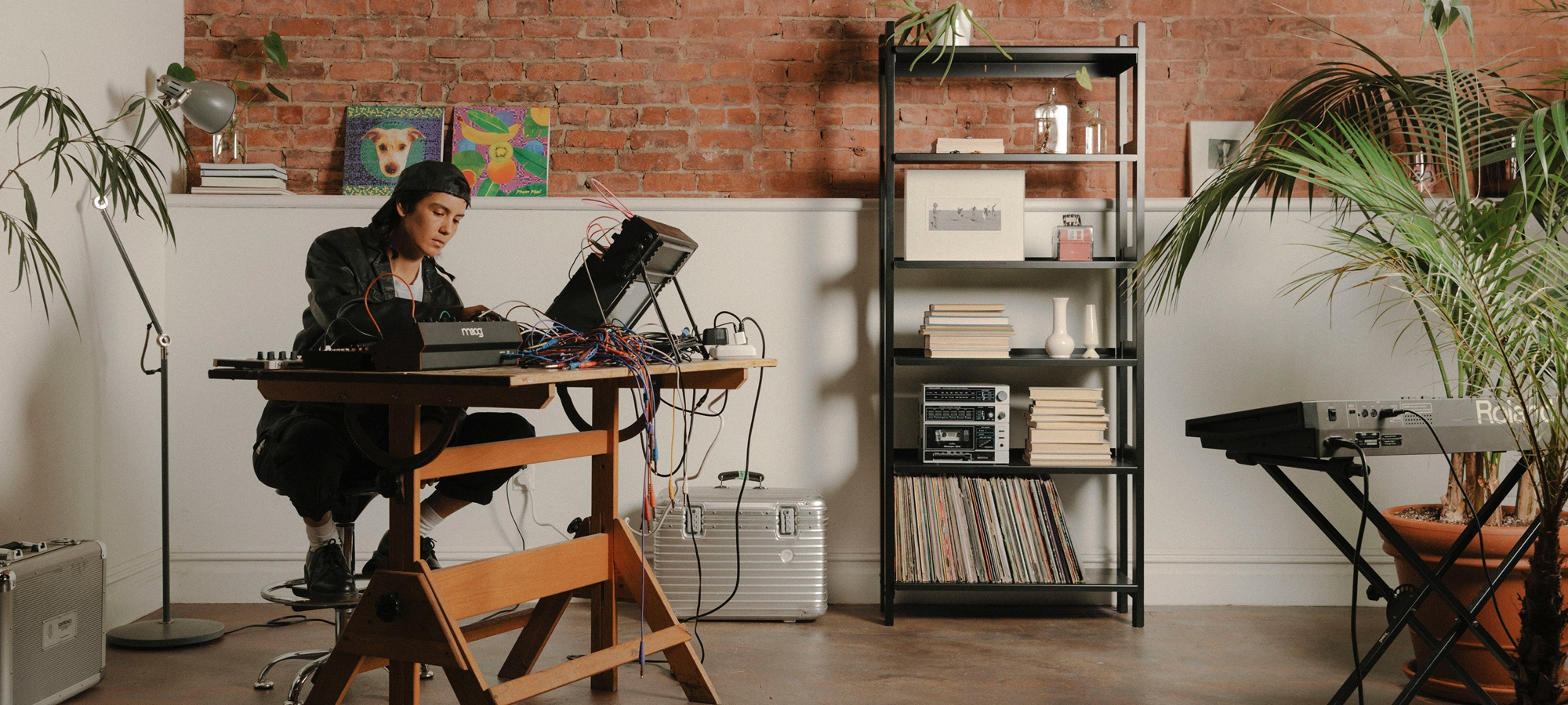 Kim Ann Foxman in her studio with a Floyd shelf.