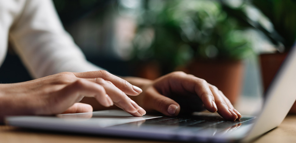 typing on laptop AdobeStock 246476033-1240x600