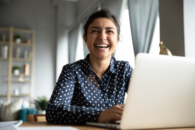 shutterstock 1606120384 woman smiling at laptop