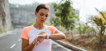 AdobeStock 332344743 1240x600 Woman checking her watch