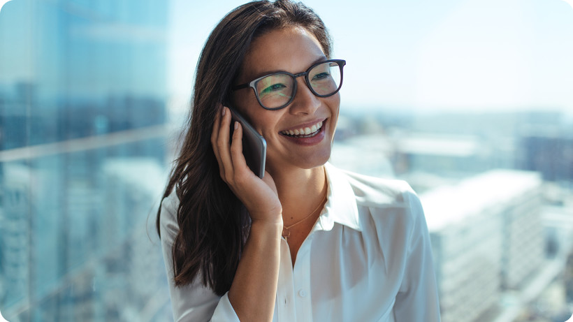happy-businesswoman-talking-phone-cityscape-1440x1120.jpg