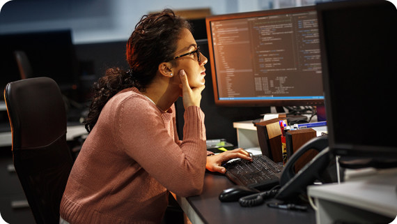 female-programmer-working-monitor-code-870x490