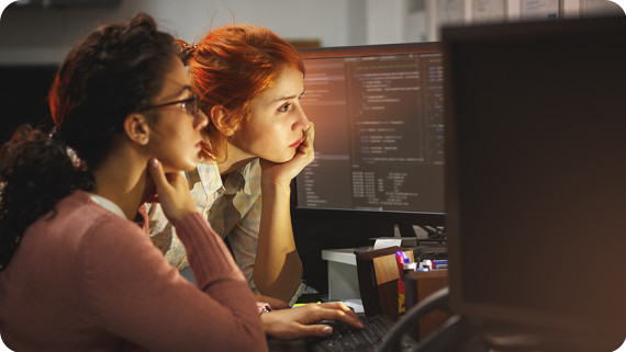 Managed-Solutions-870x490-Two female programmers working on new project