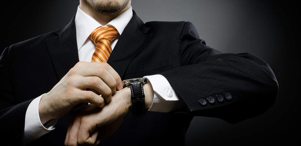 Time to Unlock Telecom's Next Innovation Wave blog hero - Man in suit checking watch