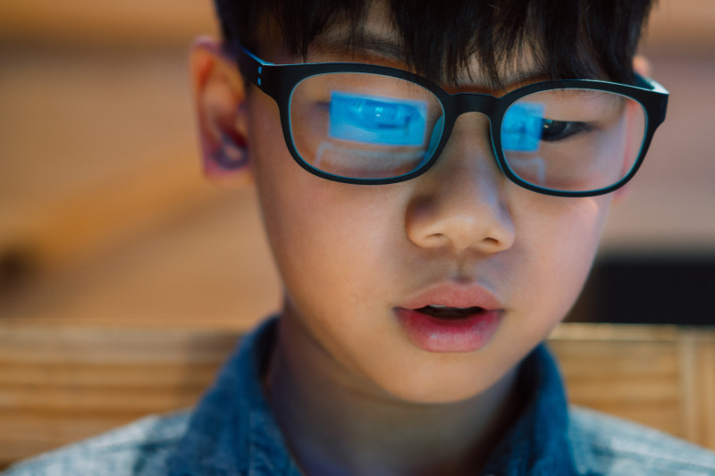 AdobeStock 280024308 boy with glasses looking at computer