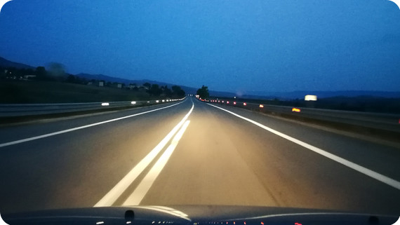view-windshield-road-dusk-870x490