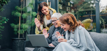 family on laptop AdobeStock 312932945-1240x600