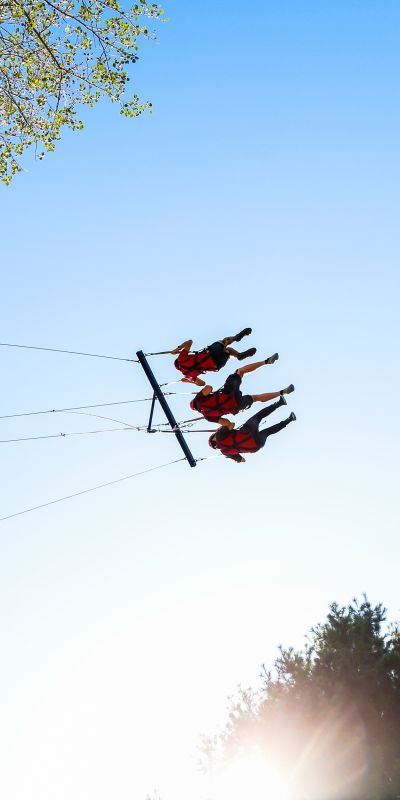 Three students on giant swing